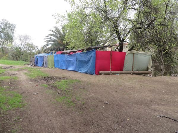 Multi-tent complex; side